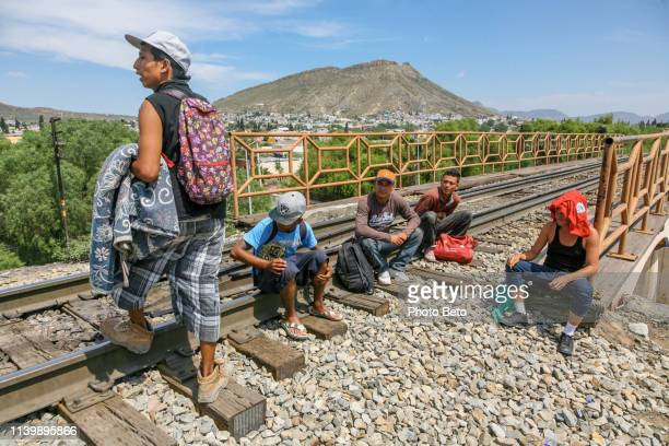 some migrants rest along the railroad near the us-mexico border in northern mexico - central america stock pictures, royalty-free photos & images