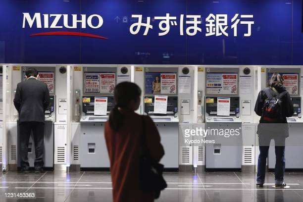 Some Mizuho Bank ATMs are seen out of service in Tokyo on March 1 due to a glitch affecting cash withdrawals and other transactions. Some ATMs of the...
