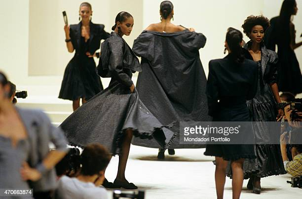 """""""Some models walking down the catwalk with sophisticated grey dresses of the new collection by Fendi. Milan , 1986. """""""