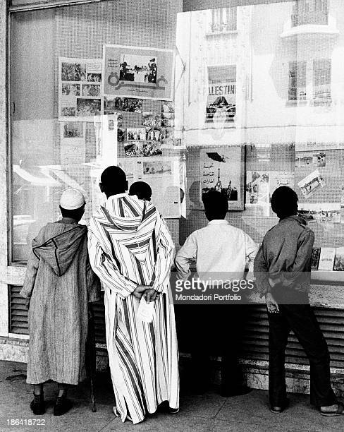 Some Moroccan men reading breaking news about the assassination attempt to King Hassan II of Morocco Rabat July 1971