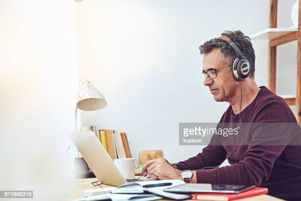 some music to get the work going - image focus technique stock pictures, royalty-free photos & images