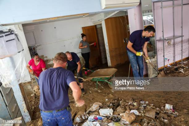 Some neighbours are seen cleaning the floor full of mud and rubbish after the heavy rains in Arganda del Rey on September 16, 2019 in Madrid, Spain.