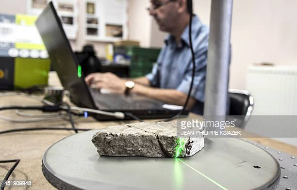 Some of 1200 broken marble pieces discovered in the 19th century in the centraleastern French city of Autun are scanned on July 4 2014 by...