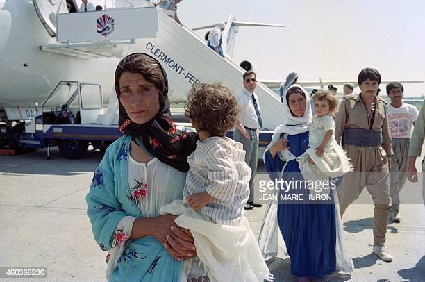 Some of 152 Iraki Kurdish refugees disembark on August 3 1989 from a plane in ClermontFerrand central France where they joined 183 other Kurds...