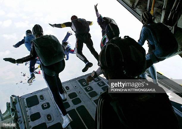 Some of 372 parachutists dive from the military plane during a rehearsal for the largest mass parachute jump in Nakhon Prathom province 21 January...