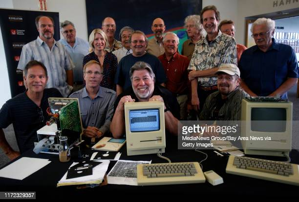 Some of Apple's earliest employees, including Steve Wozniak, center, pose for a picture with a prototype Macintosh 128K with a Twiggy disk drive at...