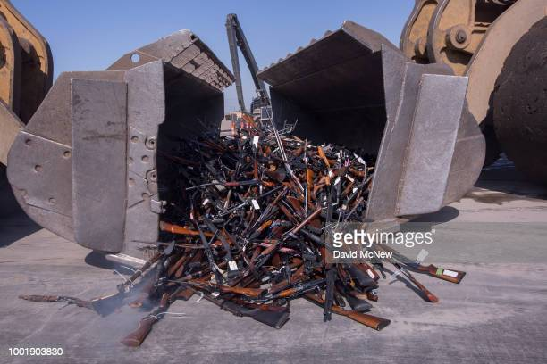 Some of approximately 3500 confiscated guns are scooped up by tractors to be destroyed at the Gerdau Steel Mill understand supervision of the Los...