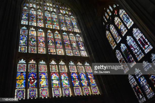 some of canterbury cathedral's about 4,000 square feet of stained glass, canterbury, england. - bo zaunders stock pictures, royalty-free photos & images