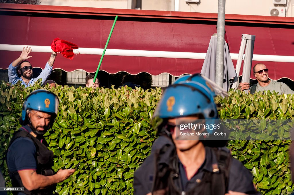 Some of Casapound's extreme right-wing wave a flag stolen from anti-fascists, after clashing with the group in front of the Fourth Town Hall, where the future of a centre for refugees was discussed on September 13, 2017 in Rome, Italy. Far right movement Casapound are demanding the closure of the centre which is run by the Red Cross in District Tiburtino IV in Rome.