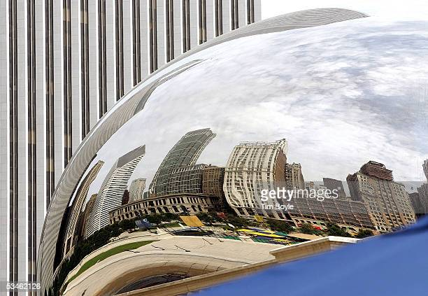 Some of Chicago's skyline is seen reflected on the 110ton stainless steel Bean also called 'Cloud Gate' sculpture at Millennium Park August 25 2005...