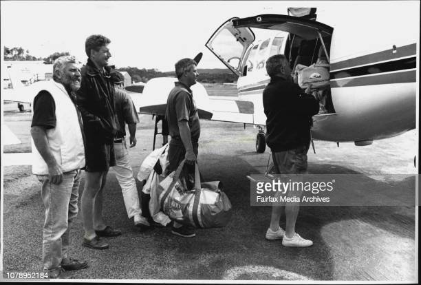 Some of freight train crew of Merimbula airport catehim plane back to Sydney after their yacht retired from raceLeft to Right Dick Beatman Dave Munro...