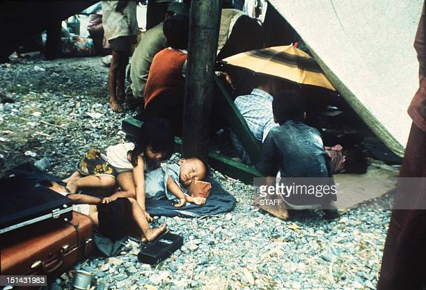 Some of more than 7,000 refugees, jampacked aboard the South Vietnamese Navy ship HQ-504, are waiting on the deck to desembark as she arrives at Vung...