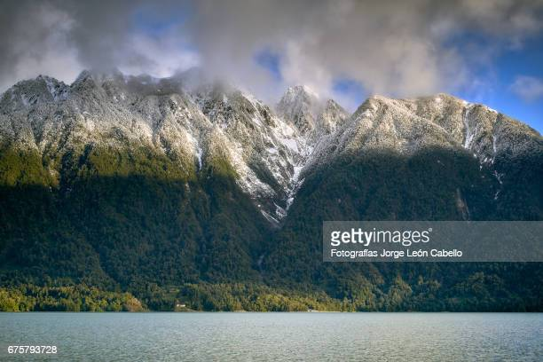 some of mountains surrounding lake todos los santos with a touch of afternoon winter sunlight - azul turquesa stock pictures, royalty-free photos & images