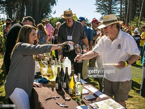 Some of nearly two thousand people attend Winesong a consumer wine tasting and charity auction held in the Mendocino Coast Botanical Gardens on...