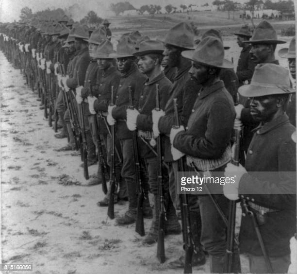 "Some of our brave collared boys who helped to free Cuba"" Formation of Black soldiers, after Spanish-American War. Stereograph. C1899."