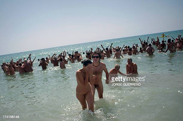 Some of several hundreds nudists react in the Mediterranean sea as they break the world record of collective bathroom of naked people with 729...