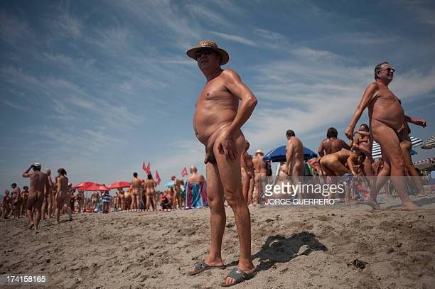 Some of several hundreds nudists stand on th beach as they break the world record of collective bathroom of naked people with 729 participants in...