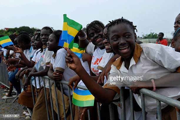Some of several thousands people wave Gabonese flags during a meeting of Gabon's President Ali Bongo Ondimba on November 16 2011 in Libreville Bongo...