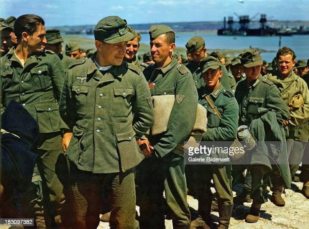 Some of the 1096 German prisoners of war who have arrived on HM Landing Ship Tank at Gosport Hampshire June 1944 This is the first transport with...