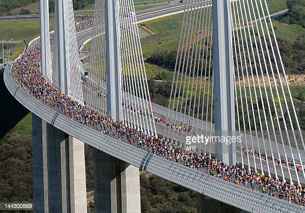Some of the 13500 competitors cross the Millau bridge as they take part in the 'Viaduc de Millau' race a 237 kilometers long race on May 13 2012 in...
