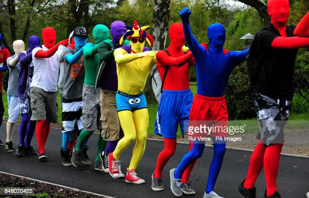 Some of the 145 people wearing Morphsuits at Drayton Manor Theme Park Tamworth where they gathered to beat last year's figure 112 people gathered in...