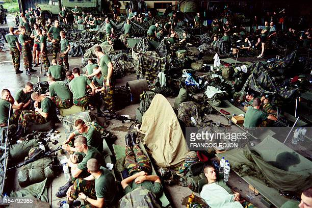 Some of the 150 French paratroopers from the Central African Republic sent to Brazzaville rest on January 30 1993 at the airport as they wait for...