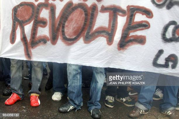 some of the 1500 students and high school students who demonstrate are pictured behind a banner reading 'Rebellion' 22 November 2007 in Lyon Eastern...