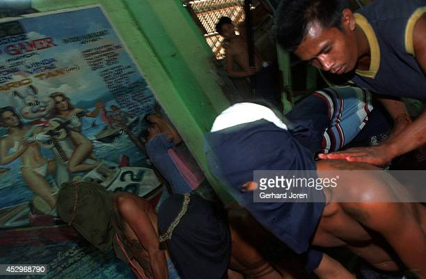 Some of the 200 inmates that performed self flagellation on Good Friday The ritual is to show repent for their crimes and to bring good luck back to...