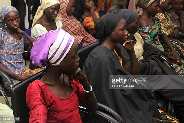 Some of the 21 freed Chibok girls are received at the Nigerian Vice President office in Abuja on October 13 2016 Jihadist group Boko Haram has freed...