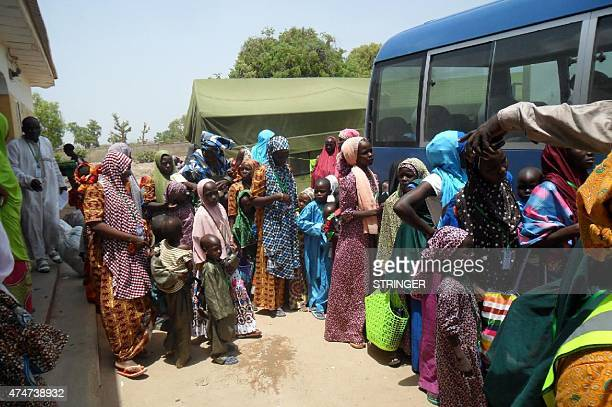Some of the 275 women and children rescued from Boko Haram during military operations leave the Malkohi camp outside the Adamawa state capital Yola...