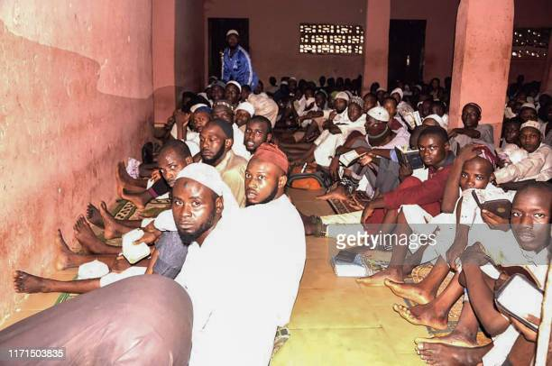 Some of the 300 male students of different nationalities sit on the floor in chains outside a torture chamber on September 26 2019 in the Rigasa area...