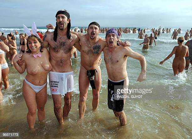 Some of the 300 people take part in a traditional bath ending the year on December 31 2009 on the nudist beach of Le Cap d'Agde southern France AFP...