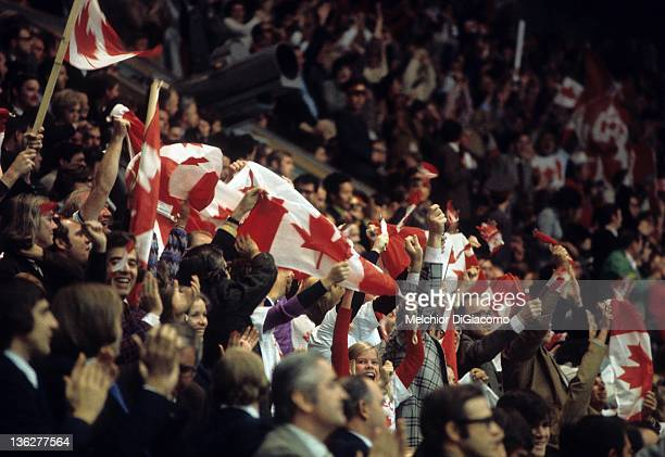 Some of the 3000 Canadian fans cheer and wave the Canadian flag during the game between Canada and the Soviet Union in Game 6 of the 1972 Summit...