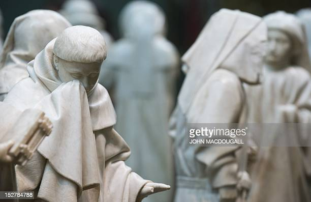 Some of the 37 alabaster statues depicting mourners are displayed as part of the exhibition 'Lamentations for a Dead Prince The Pleurants from the...