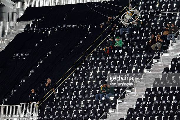 Some of the 400 temporary seats that will no longer be used since they were not complete are marked off before the Pittsburgh Steelers play against...