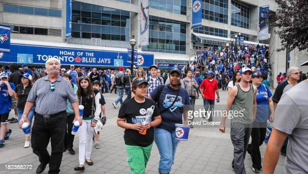 Some of the 44,551 who attended the last game of the season stream out of the Rogers Centre after the Toronto Blue Jays lost their final game of the...