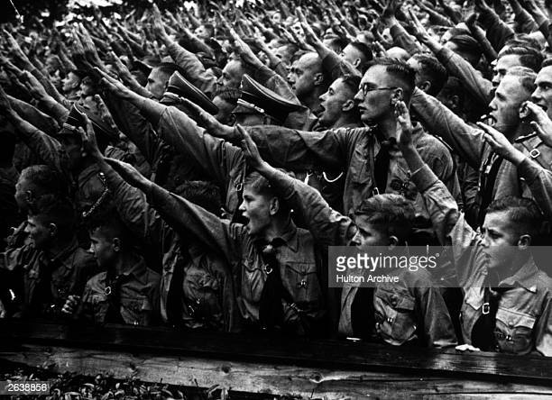 Some of the 48000 boys and 5000 girls who attended the Nazi Party Congress rally in Nuremberg cheering and saluting Adolf Hitler's speech