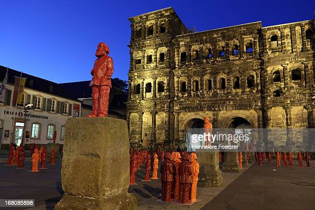 Some of the 500 one meter tall statues of German political thinker Karl Marx in front of the Porta Nigra on display on May 5 2013 in Trier Germany...
