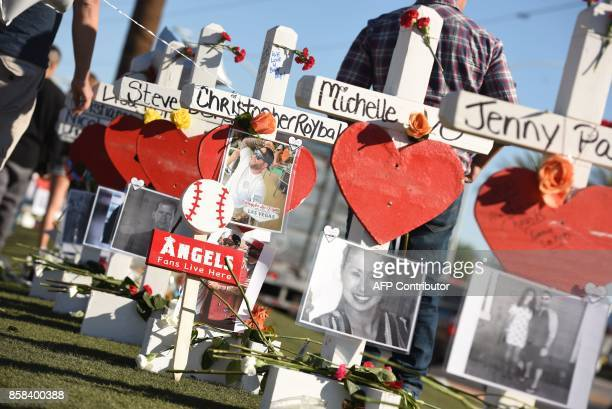 Some of the 58 white crosses for the victims of Sunday night's mass shooting on Las Vegas Strip just south of the Mandalay Bay hotel October 6 2017...