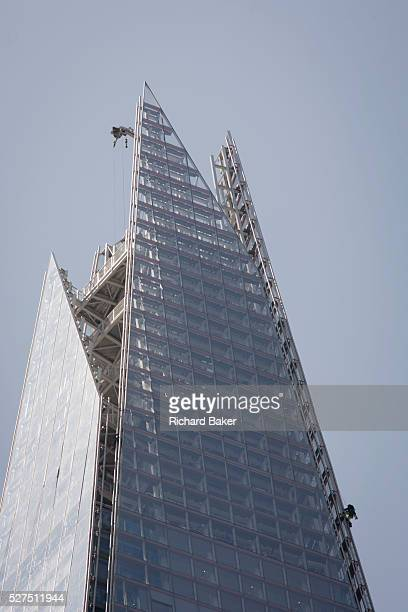 Some of the 6 Greenpeace climbers protesting against Shell's plans to drill for oil in the Arctic, scale the London skyscraper landmark known as The...