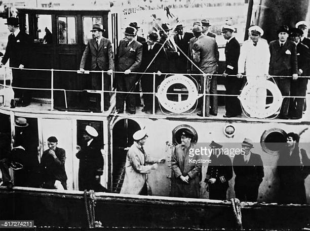 Some of the 61 captive British merchant seamen formerly held aboard the German cruiser Admiral Graf Spee arrive at Montevideo harbour Uruguay after...