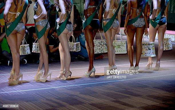 Some of the 86 contestants vying for the Miss Earth 2014 are presented to the media in Manila on November 10 2014 The winner of Miss Earth 2014 will...