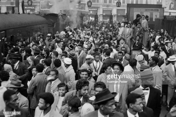 Some of the 981 West Indian immigrants newly arrived at Waterloo Station London on the boat train from Southampton 15th October 1961