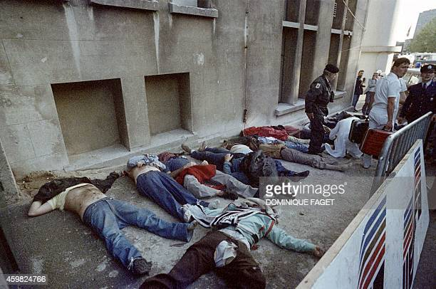 Some of the bodies of dead spectators are lying next to the stands on May 29 1985 after 39 people lost their lives in violent incidents inside the...
