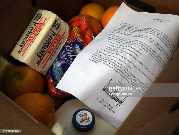 Some of the boxes of food distributed on September 29 by the Greater Auburn-Gresham Development Corporation in Chicago came from the federal...