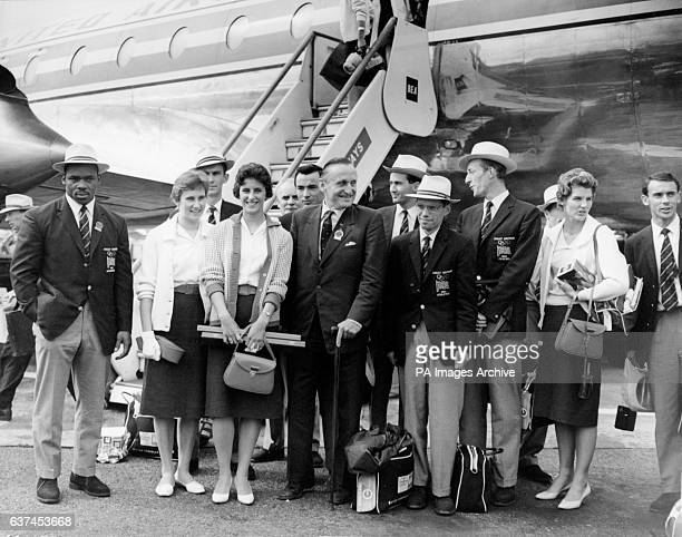 Some of the British medallists pictured upon their arrival at London Airport weightlifter Louis Martin high jumper Dorothy Shirley 100m runner...