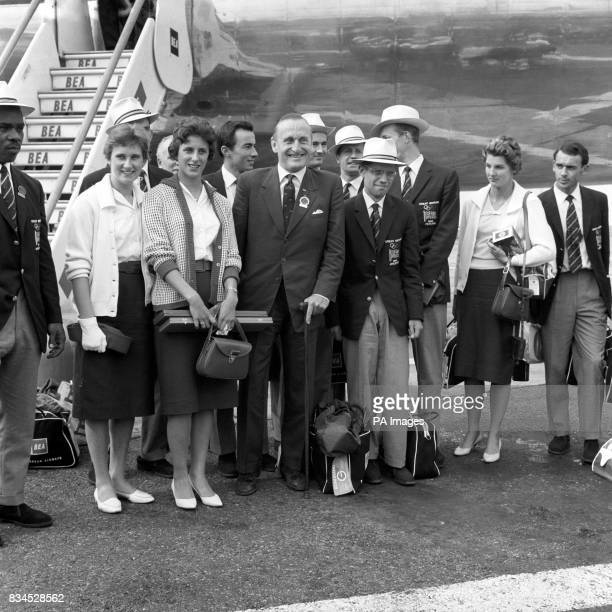 Some of the British medallists pictured upon their arrival at London Airport High jumper Dorothy Shirley 100m runner Dorothy Hyman Lord Burghley The...