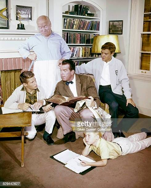 Some of the cast of the American TV sitcom 'My Three Sons' circa 1963 Left to right Don Grady William Frawley Fred MacMurray Stanley Livingston and...