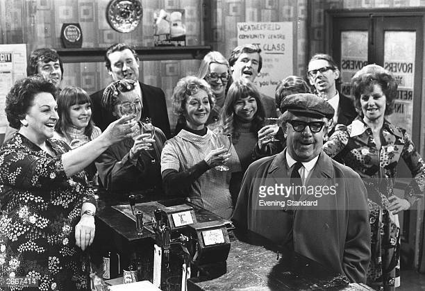 Some of the cast of the British television soap opera 'Coronation Street' in the bar of the show's pub