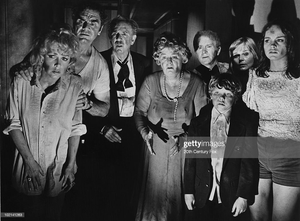 Some of the cast of 'The Poseidon Adventure', directed by Ronald Neame and Irwin Allen, 1972. Left to right: Stella Stevens, Ernest Borgnine, Jack Albertson (1907 - 1981), Shelley Winters (1920 - 2006), Red Buttons (1919 - 2006), Eric Shea, Carol Lynley and Pamela Sue Martin.